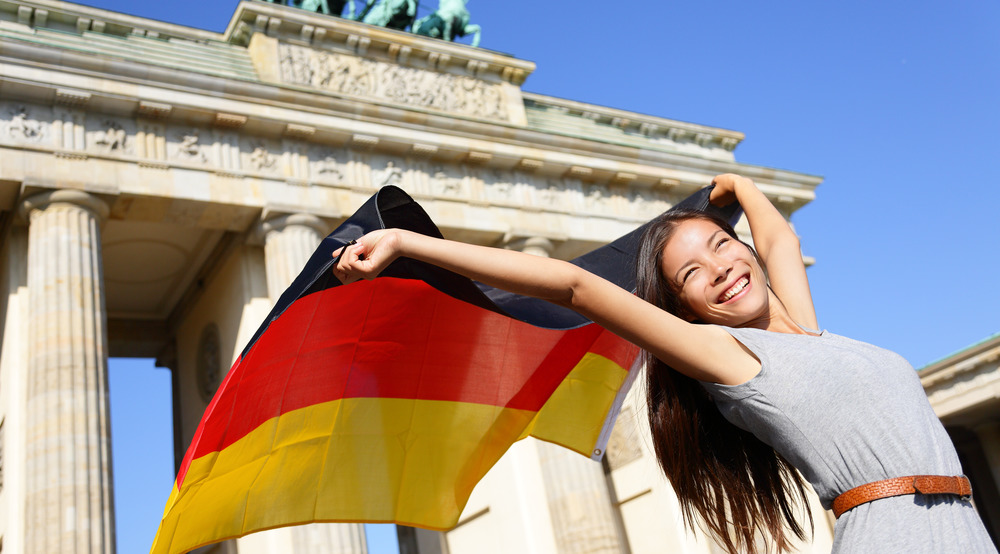 girl holds German flag msmstudy.eu
