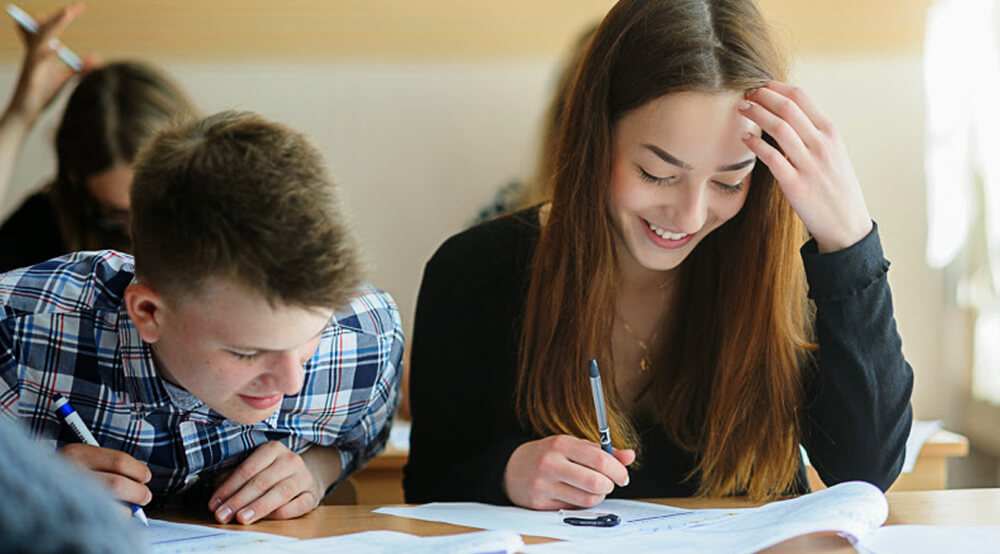 girl and boy are taking an exam