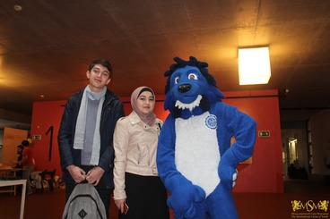 students from the middle east are photographed near blue lion from Czech Technical University (CTU) msmstudy.eu